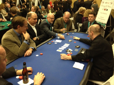 Hold'em players waiting to see who the winner of the hand will be.