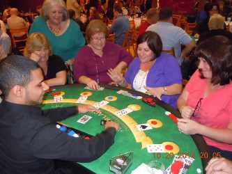 Guests thoroughly enjoying playing a game of blackjack.